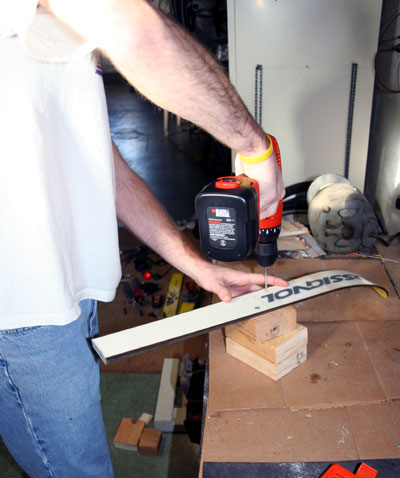screwing ski to wood block