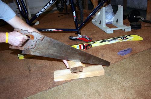 cutting wood for the ski bike